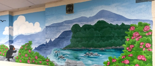 A 25 foot by 3 foot mural with details.