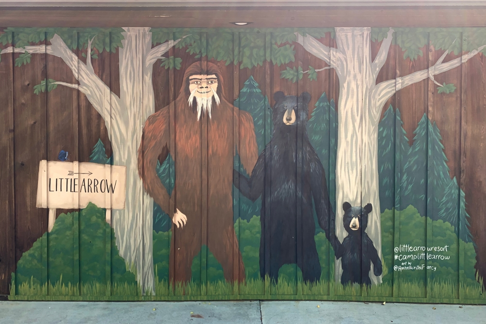 Finished mural with bigfoot, bear, and bear cub